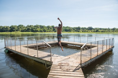 jumping_to_ngepi_fenced_pool