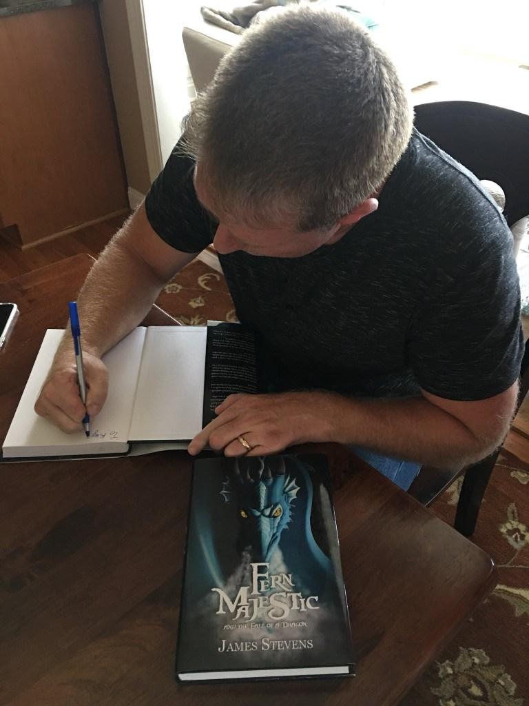 James Stevens signing a copy of his book. Rob Gregory Author