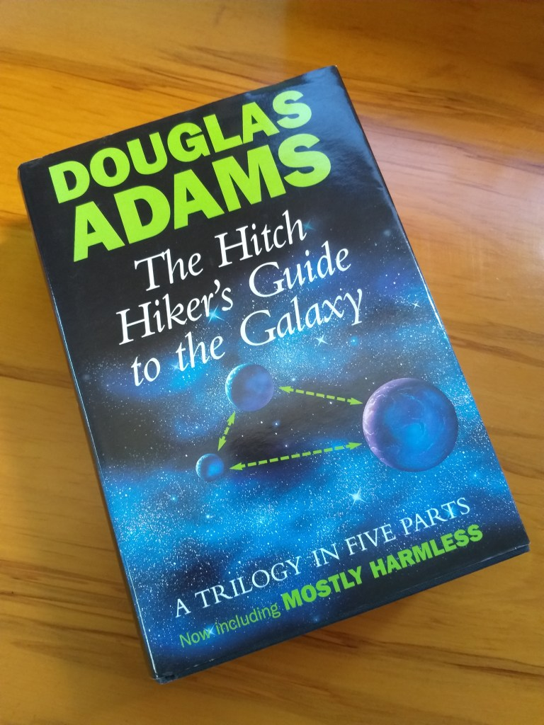 Front cover of the 1995 hardback edition of The Hitch Hiker's Guide to the Galaxy - Rob Gregory Author