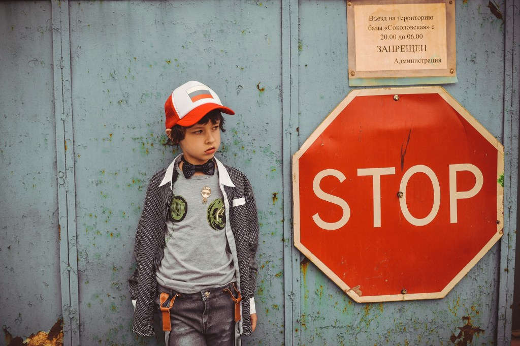 Young boy next to a stop sign - Rob Gregory Author