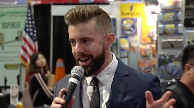 Trade show presenter Rob Anderson promotes an exhibitors booth at SEMA in Las Vegas