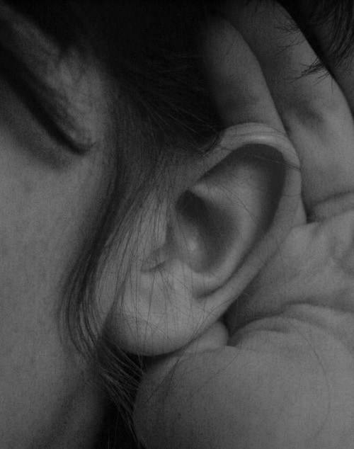 Image of a hand cupped behind and ear