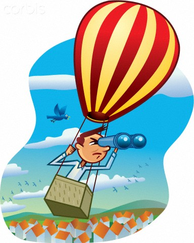 A man looking through binoculars while on a hot air balloon