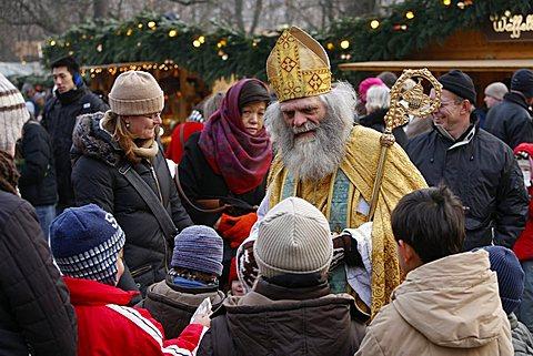 St. Nicholas impersonator at Munich Christmas market, Munich, Bavaria, Germany, Europe