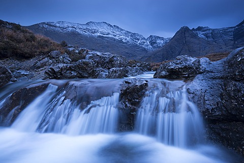 Fairy Pools waterfalls at Glen Brittle, with the snow dusted Cuillin mountains beyond, Isle of Skye, Inner Hebrides, Scotland, United Kingdom, Europe