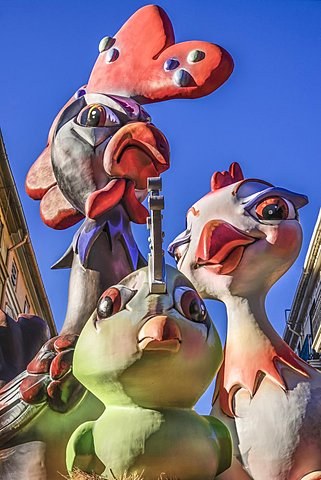 Spain, Valencia Province, Valencia, Papier Mache figures in the street during Las Fallas festival.