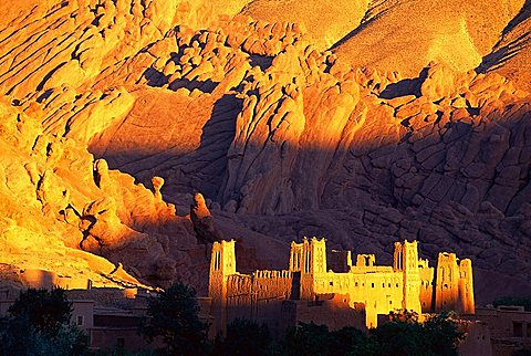 Fort in the Gorge of the Dades, catching dusk light, High Atlas Mountains, Morocco, Africa.