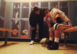 Coach Consoling Dejected Football Player