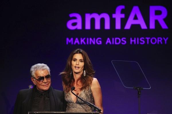 Roberto Cavalli and Cindy Crawford speak at the annual amfAR New York Gala