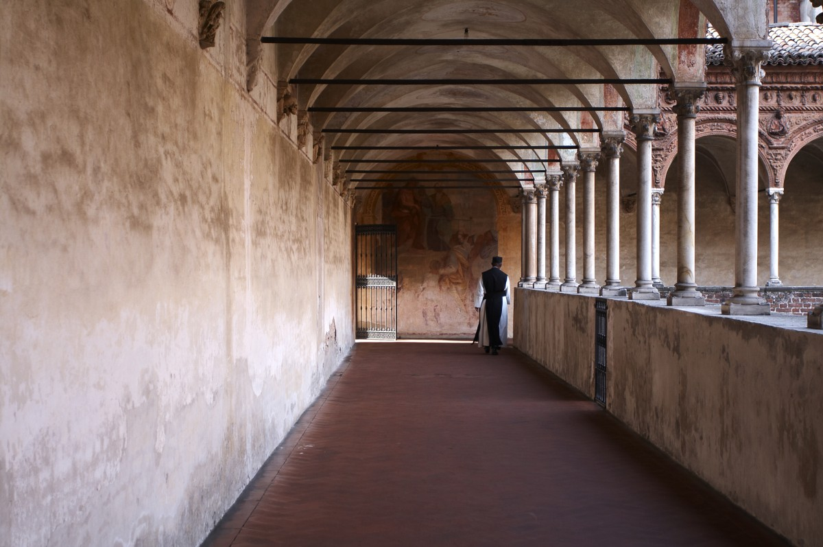 Monk walking in the cloister