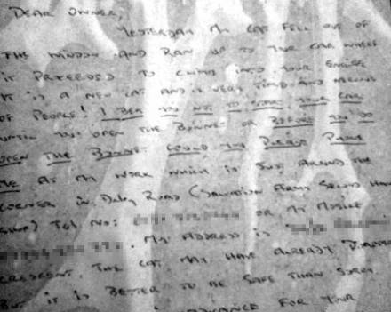Close up of the note about the cat