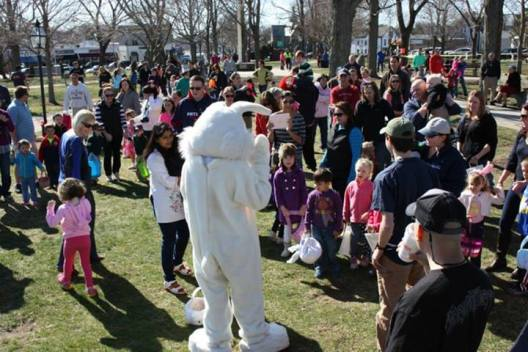 The Easter Bunny greets the crowd under a spectacular blue sky and the warmest Saturday in recent memory.