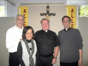 Welcome-St. Mary's Church here in Foxboro recently welcomed a new priest and a new deacon to their parish family. From left: Deacon Paul Kline and his wife Rosemary, Reverend and Pastor Stephen J. Madden and Reverend Brian P. Smith, Parochial Vicar. (Photo by Christine Igo Freeman, Foxboro Reporter)