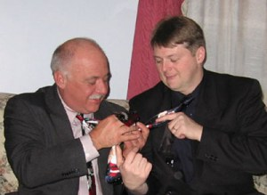 Tom and I compare who has the best Christmas tie at the 2005 Jaycee Progressive Dinner