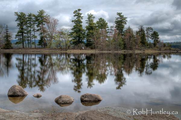 Four rocks and river reflections at Pinhey's Point Heritage Property and Park.