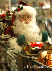 Santa in a shop window. Louise's Belgian Chocolates shop in the community of Westboro in Ottawa, Ontario.