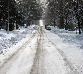 An ordinary picture of an ordinary suburban street on an ordinary winter day. This is my street in the Westboro, Highland Park area of Ottawa, Ontario. It was actually a great morning for a walk despite the gloomy look to this image.