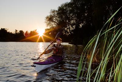 Solitary Paddler at Sunset