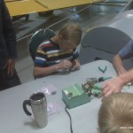 Folks having fun soldering electronic components