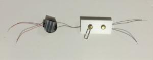 Corrugated plastic square glued to back of battery holder.