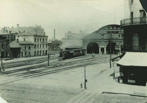 A view of the first New York Central Railroad station located between Mill Street and Front Street. This station replaced a wooden structure, known as the Auburn Railroad shed, in 1852. It remained open until 1883 when a more modern station was constructed.