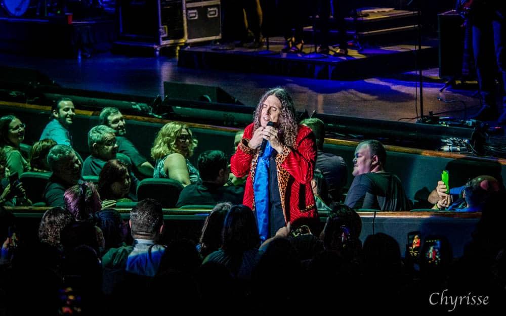 """""""Weird Al"""" singing to audience members"""
