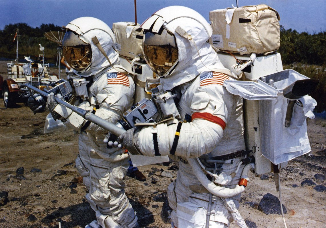 Apollo 17 crew members Gene Cernan and Harrison Schmitt work together during a lunar EVA simulation at Kennedy Space Center in Florida. They are the last humans to walk upon the surface of the Moon. Credit: NASA via J.L. Pickering/Retro Space Images