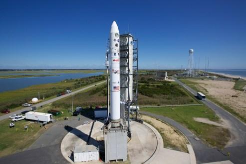 The Minotaur V rocket (left) that will carry NASA's LADEE awaits launch from Pad 0B at NASA's Wallops Flight Facility at Wallops Island, Va. Credit: NASA EDGE