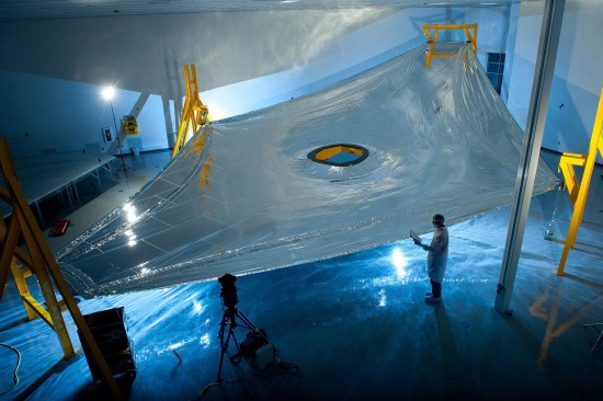 A full-scale JWST sunshield membrane is deployed on the membrane test fixture ready for a precise measurement of its three dimensional shape. Image: Northrop Grumman Aerospace Systems