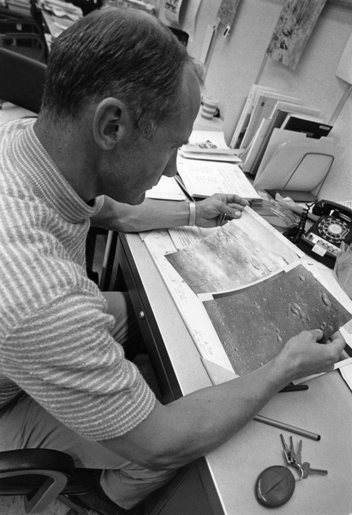 """Edwin """"Buzz"""" Aldrin reviews photos of the lunar surface at KSC on July 14, 1969."""