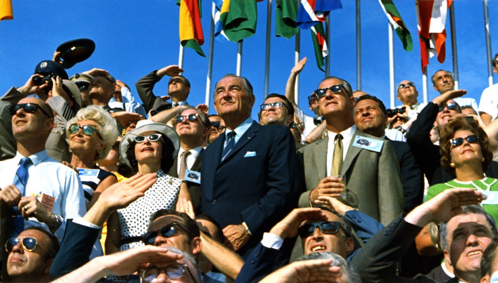 Vice President Spiro Agnew (gray blazer) and former President Lyndon B. Johnson (blue suit) view the liftoff of Apollo 11.