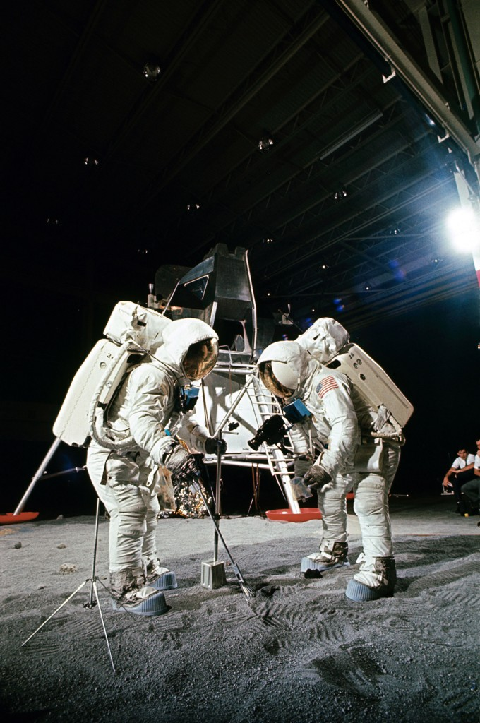 Edwin 'Buzz' Aldrin and Neil Armstrong participates in an EVA simulation of deploying and using lunar tools on the surface of the Moon during a training exercise in Building 9 of the MSC at Houston, Texas on April 18, 1969.
