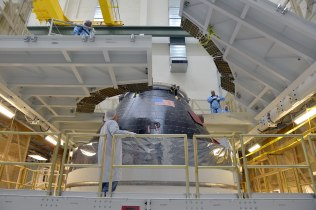 Orion is mated to the Service Module and nearly ready to meet the Delta IV Heavy rocket that will lift it into space in early December. Credit: NASA