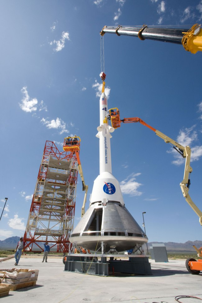 Ground teams practice stacking test versions of Orion and its launch abort system. Credit: NASA