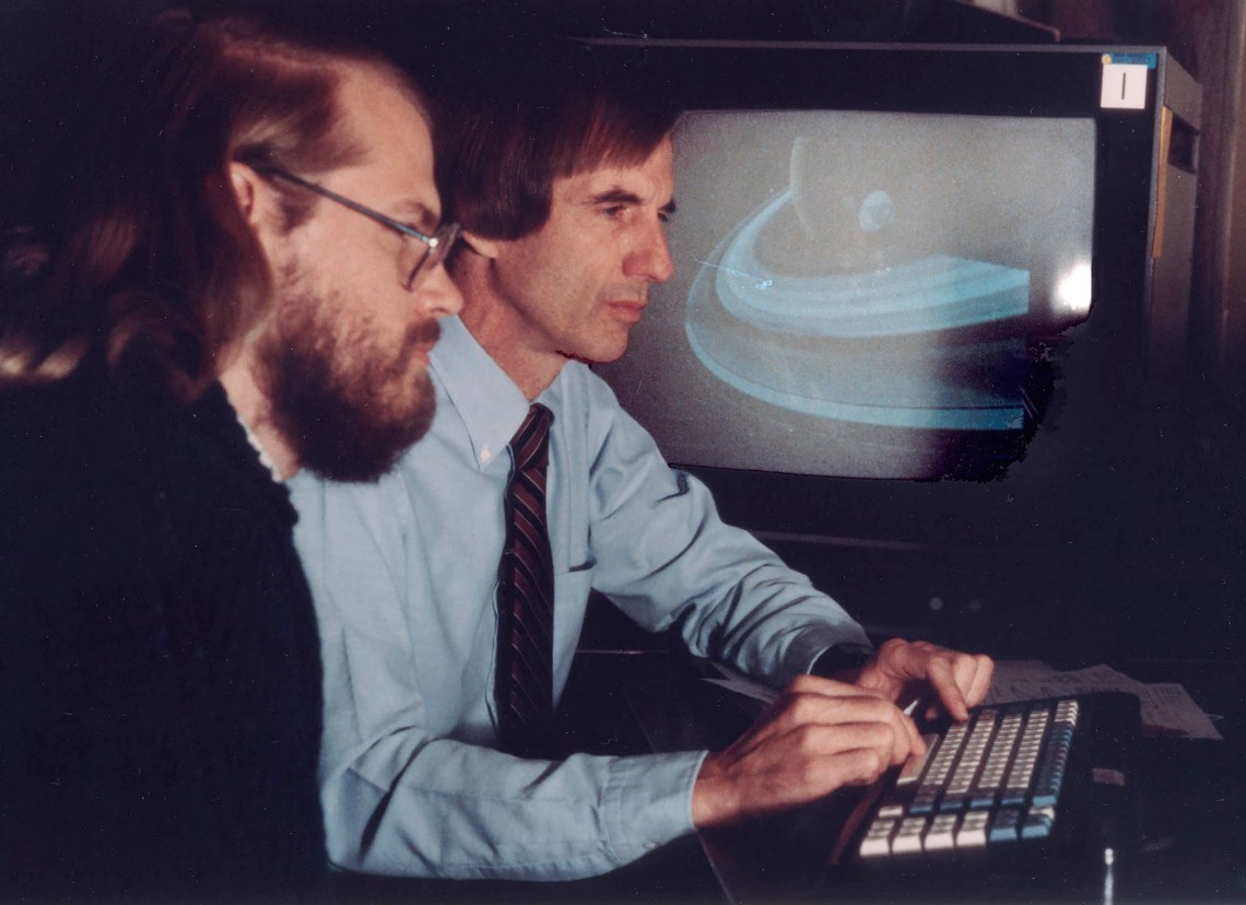 James Blinn (far left) and Charles Kohlhase working at JPL on the revolutionary computer animations of the planned Voyager encounters with the outer planets. Credit: Charles Kohlhase