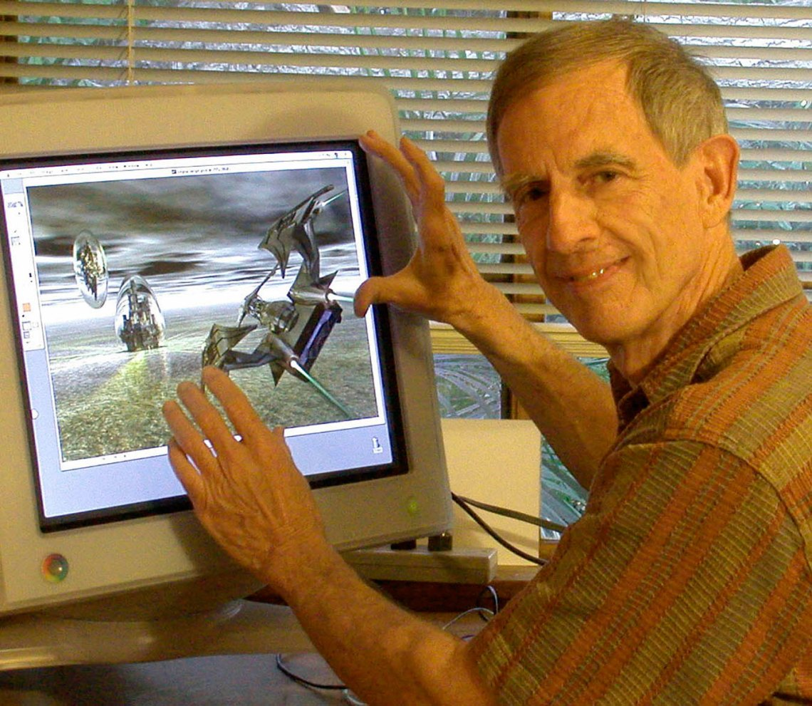 Charley at work in his home in 2010, designing a futuristic space scene.