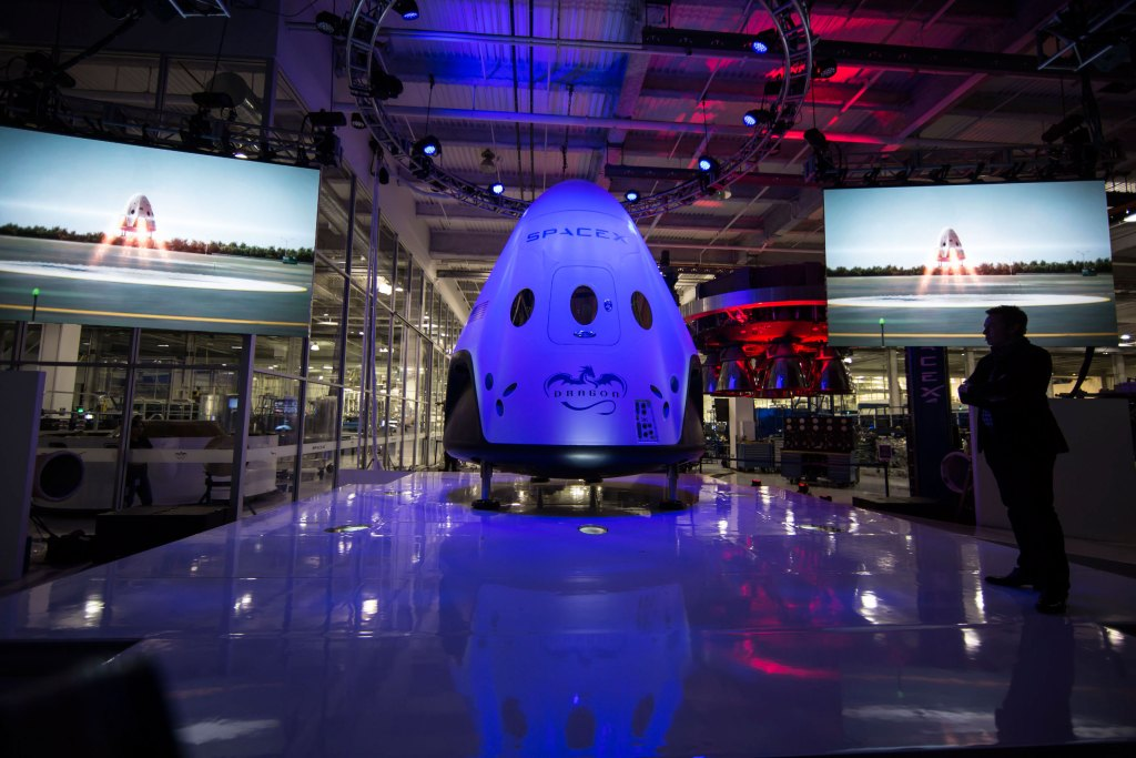Elon Musk reveals the Dragon V2 that will serve as the first SpaceX spacecraft to be human rated. Credit: SpaceX