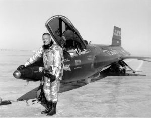 Neil Armstrong stands next to the X-15 ship after a research flight.