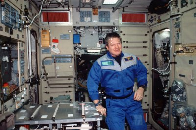 Expedition One commander William (Bill) Shepherd poses for a photo in the Zvezda Service module of the International Space Station Alpha. Credit: NASA