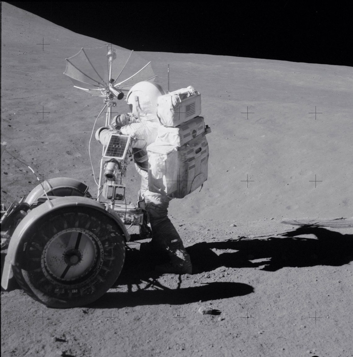 Working at Spur Crater during the second EVA. Credit: NASA via Retro Space Images