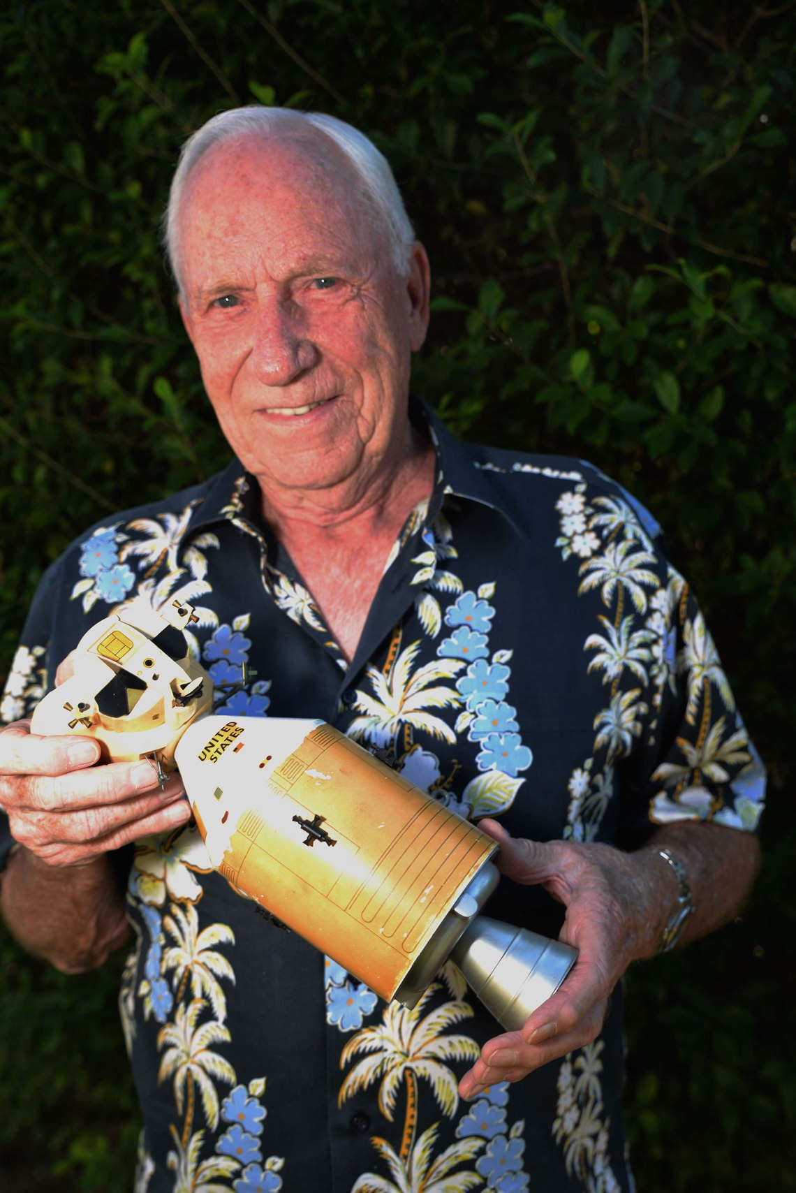Al Worden with a model of the Command Module and Lunar Lander in 2014. Credit: Julian Leek