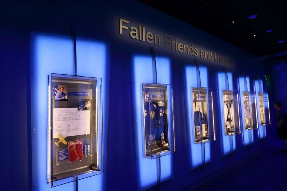 Displays line a wall with personal items for each crew member of the STS-51L mission lost aboard Challenger. Credit: Lloyd Campbell