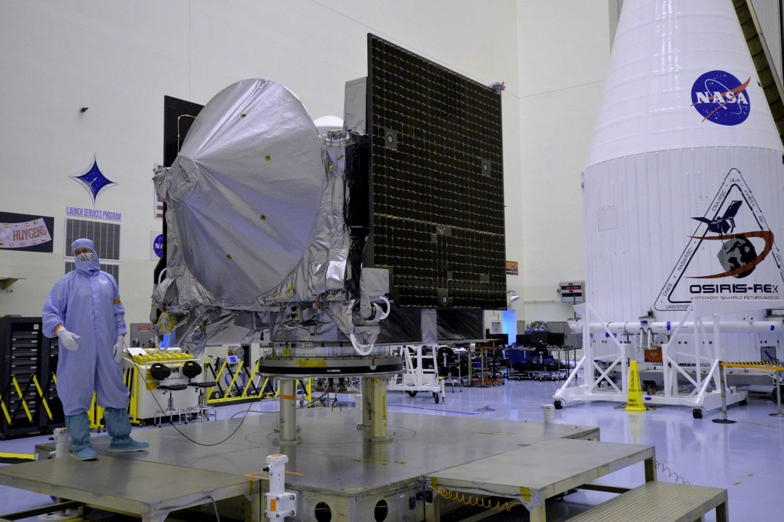 The OSIRIS-REx spacecraft resides in cleanroom as it undergoes final preparations before encapsulation for launch aboard an Atlas V rocket on Sept. 8. Credit: Julian Leek/JNN