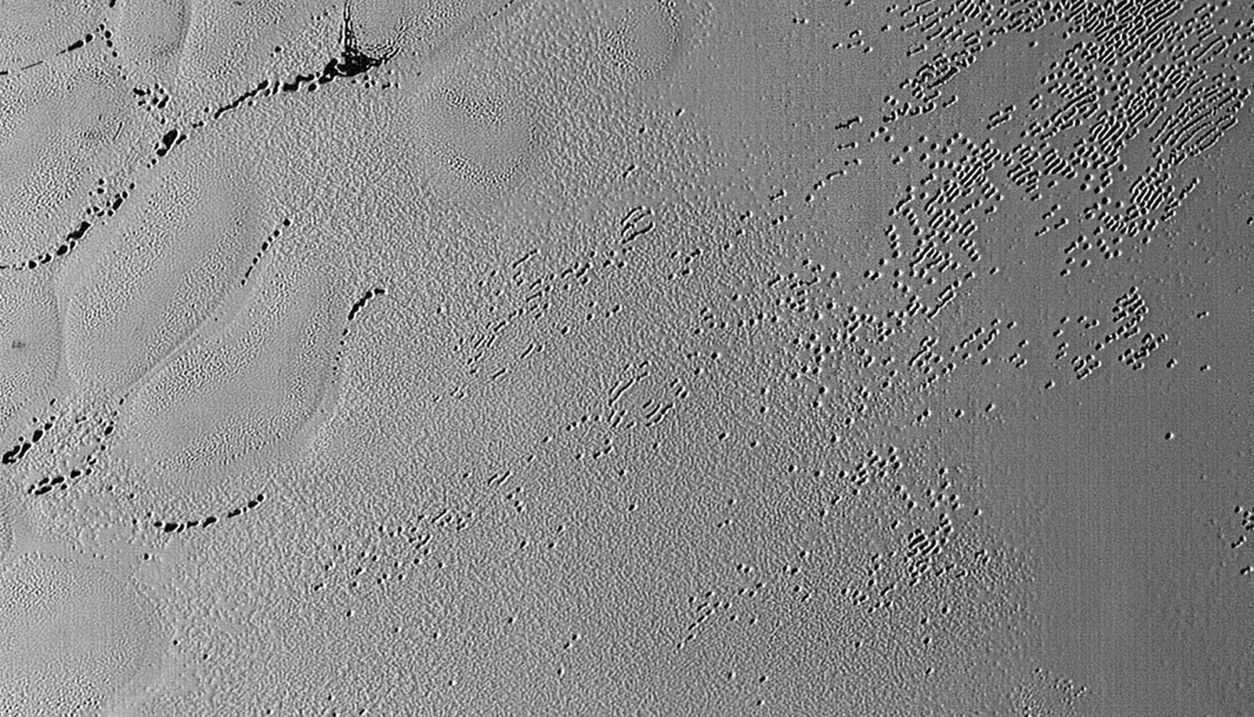 Figure 10: Pitted terrain on Sputnik Planum. Credit: NASA/JHUAPL/SwRI