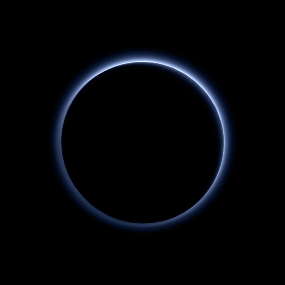 Figure 16: Pluto's 'blue skies', imaged by New Horizons' Ralph/ Multispectral Visible Imaging Camera (MVIC). This blue colour results from the scattering of sunlight by very small particles, in this case probably tholins, soot-like particles created by complex chemical reactions of nitrogen and methane initiated by ultraviolet light from the Sun. Credit: NASA/JHUAPL/SwRI