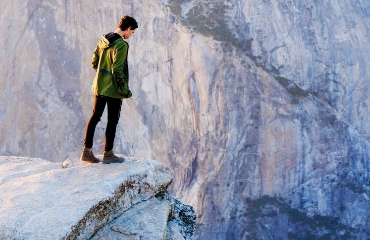 man standing at edge of a cliff
