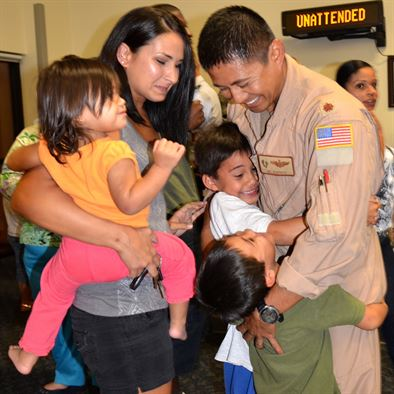 Air Force officer with wife and kids