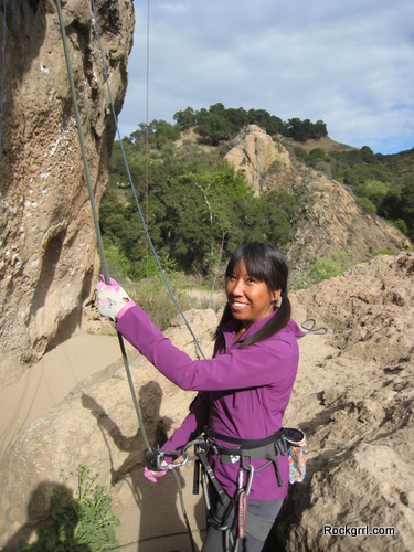 Belaying with the OR Women's Belay Gloves and wearing a Whirlwind Hoody