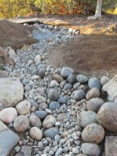 Inspiring Dry Riverbed and Creek Bed Landscaping Ideas 23