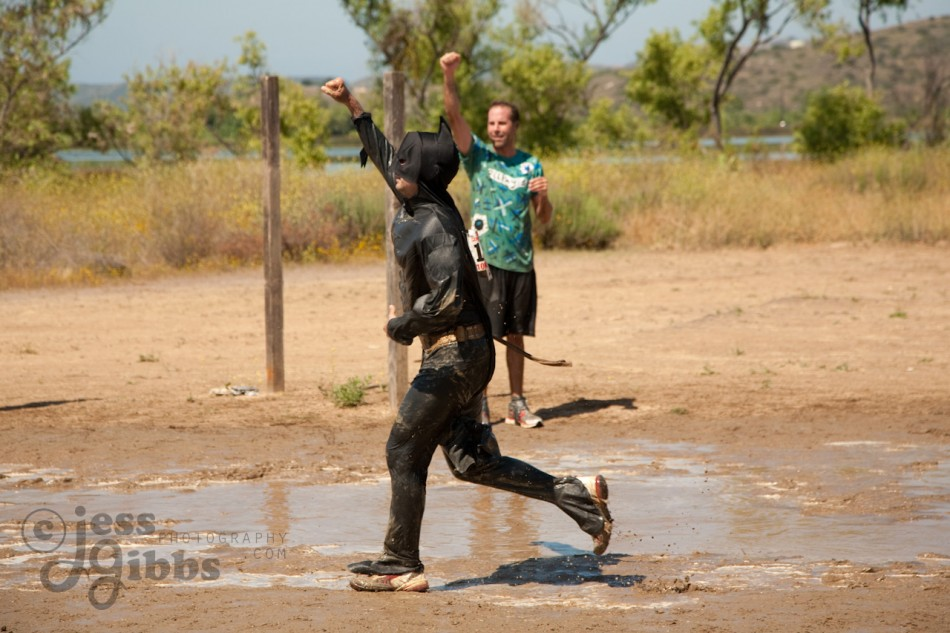 competitor_salutes_wet_muddy_batman_with_fist_in_air-950x633